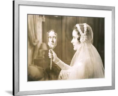 Bride Gazing into Hand Mirror--Framed Photo