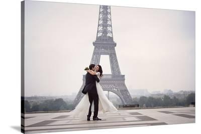 Bride & Groom at Eiffel Tower--Stretched Canvas Print
