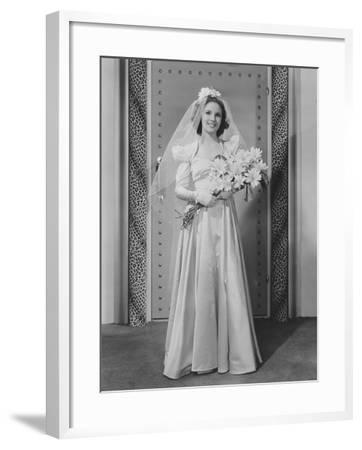 Bride Holding a Bouquet--Framed Photo
