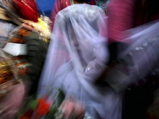 Bride Sits Next to Groom During a Mass Marriage Ceremony for About 50 Couples in Amritsar, India--Photographic Print