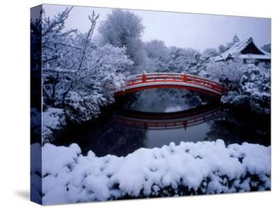 Bridge in Sinsen-En Garden in Snow, Kyoto, Japan