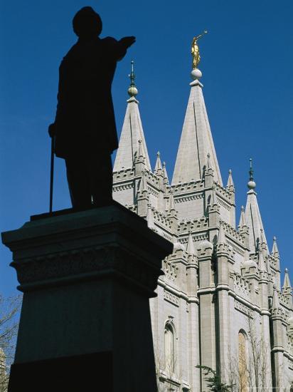 Brigham Young Statue Frames the Jesus Christ Latter Day Saints Church-Stephen St^ John-Photographic Print