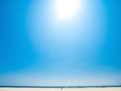Bright Blue Sky with Sun Shining over a Beach--Photographic Print