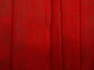Bright Red Fire Hose Made of Tightly Woven Fabric and Folded into Layers--Photographic Print