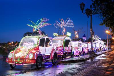 Brightly coloured illuminated pedal cars in yogyakarta city java
