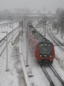 One Red Train on Snow Day, Copenhagen, Denmark by Brimberg & Coulson