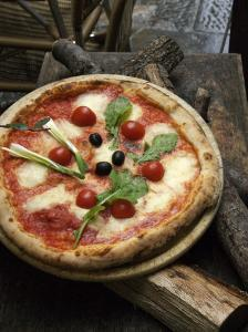 Pizza on Display Outside a Restaurant, Florence, Italy by Brimberg & Coulson