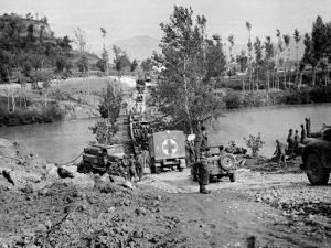 British and American Transport and Supplies Crossing a Pontoon Bridge over the Volturno River