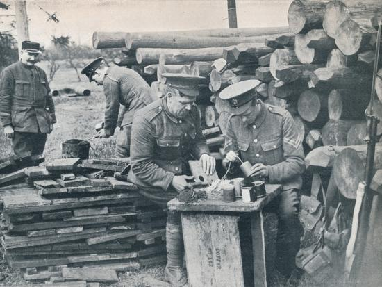 British engineers with the Expeditionary Force making hand grenades out of tobacco tins, c1914-Unknown-Photographic Print
