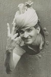 British Indian Soldier He Gives the 'V' Sign from a Port-Hole of a Ship on Arrival in Singapore