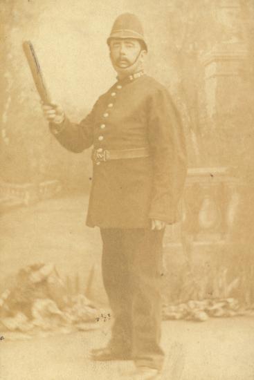 British Policeman Holding His Truncheon--Photographic Print