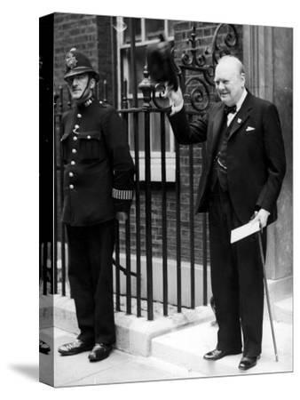British Prime Minister Winston Churchill Doffing Hat Outside of 10 Downing St--Stretched Canvas Print
