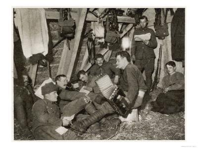 British Soldiers off Duty Smoking and Listening to an Accordion at the Front Somewhere in Flanders--Giclee Print