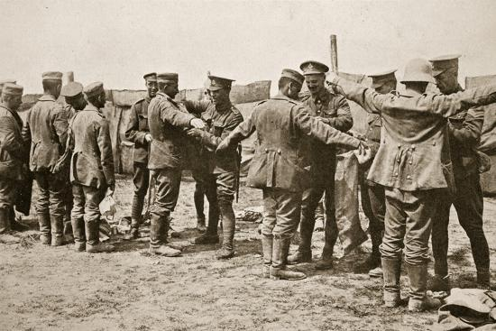 British soldiers searching captured German prisoners, Somme campaign, France, World War I, 1916-Unknown-Photographic Print