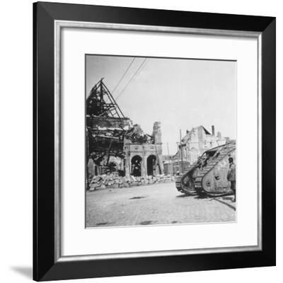 British Tank in Front of Ruined Buildings, Peronne, France, World War I, C1916-C1918- Nightingale & Co-Framed Giclee Print