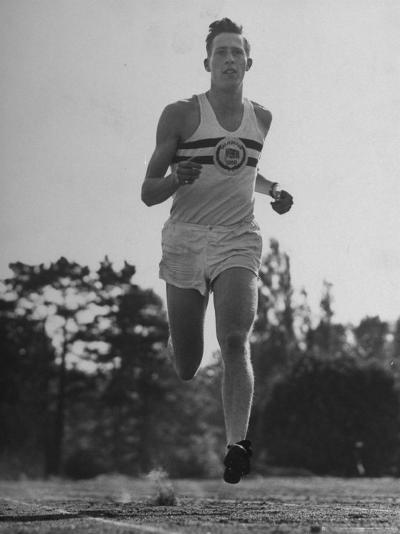 British Track Runner Roger Bannister Running, the First Person to Run a Mile in under Four Minutes-Cornell Capa-Premium Photographic Print