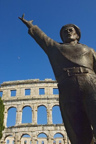 Bronze Statue in Front of Roman Amphitheater-Design Pics Inc-Photographic Print