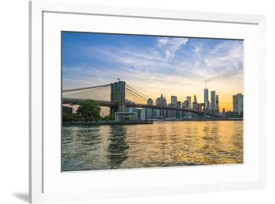 Brooklyn Bridge and Manhattan skyline at dusk, viewed from the East River, New York City, United St-Fraser Hall-Framed Photographic Print