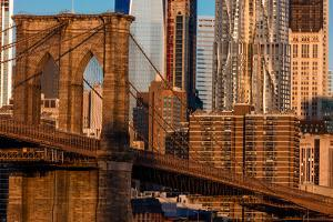 Brooklyn Bridge and Manhattan Skyline features One World Trade Center at Sunrise, NY NY