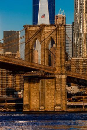 Brooklyn Bridge and Manhattan Skyline features One World Trade Center at Sunrise, NY NY
