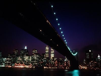 Brooklyn Bridge and Skyline of New York City at Night--Photographic Print