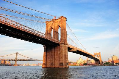 Brooklyn Bridge over East River Viewed from New York City Lower Manhattan Waterfront at Sunset.-Songquan Deng-Photographic Print
