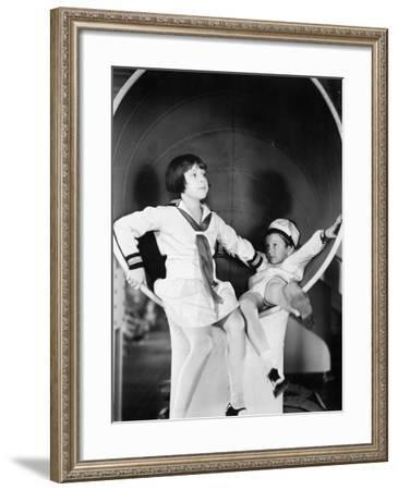 Brother and Sister Playing around on a Big Ship--Framed Photo