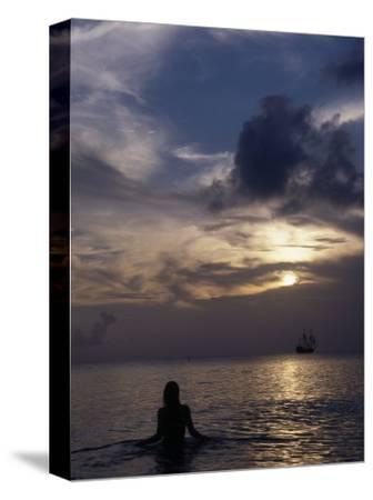 Woman Looking at Tall Ship, Cayman Islands
