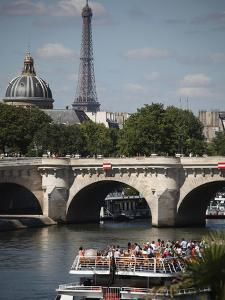 Tour Boat in River Seine with Pont Neuf and Eiffel Tower in the Background, Paris, France by Bruce Yuanyue Bi