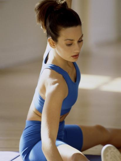 Brunette Stretching--Photographic Print