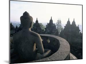 Arupadhatu Buddha, 8th Century Buddhist Site of Borobudur, Unesco World Heritage Site, Indonesia by Bruno Barbier