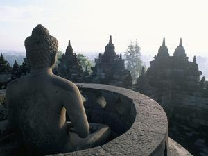 Arupadhatu Buddha, 8th Century Buddhist Site of Borobudur, Unesco World Heritage Site, Indonesia by Bruno Barbier