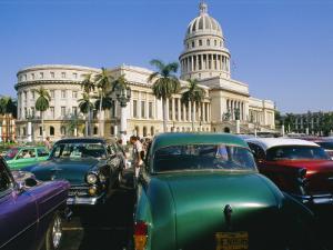 Old 1950s American Cars Outside El Capitolio Building, Havana, Cuba by Bruno Barbier