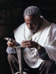 Portrait of a Blacksmith at Work, Town of Axoum (Axum) (Aksum), Tigre Region, Ethiopia, Africa by Bruno Barbier
