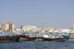 Trading Dhows on the Docks of Dubai Creek, Deira, Dubai, United Arab Emirates, Middle East by Bruno Barbier