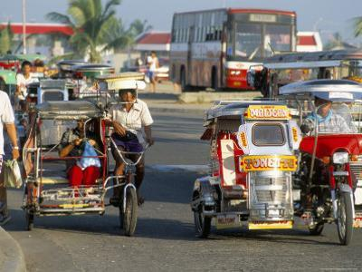 Trishaws, Port of Lucena, Southern Area, Island of Luzon, Philippines, Southeast Asia by Bruno Barbier