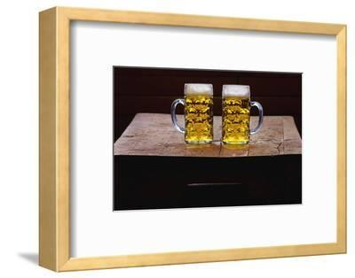 Two Glass Mugs of Beer on Table