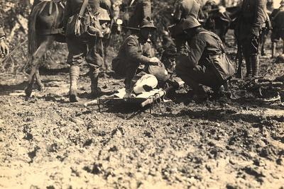 Injured Soldier Lying on a Stretcher, Aided by Some Companions