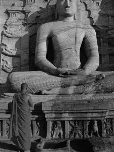 Monk in Front of the Seated Buddha Statue, Gol Vihara, Polonnaruwa, Sri Lanka, Asia by Bruno Morandi