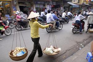 Porter in the Old Quarter, Hanoi, Vietnam, Indochina, Southeast Asia, Asia by Bruno Morandi