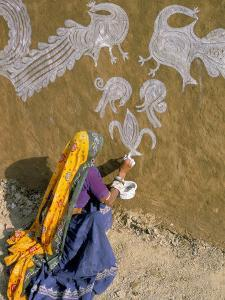 Woman Painting Designs on Her House, Tonk Region, Rajasthan State, India by Bruno Morandi