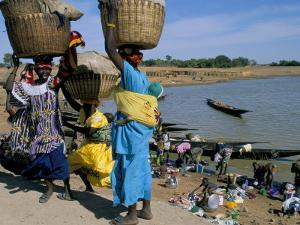 Women with Baskets of Laundry on Their Heads Beside the River, Djenne, Mali, Africa by Bruno Morandi