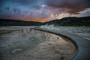 Evening Storm Clouds Gather Over Biscuit Basin In Yellowstone National Park by Bryan Jolley