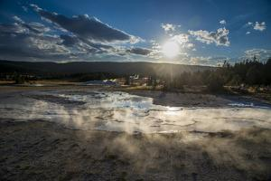 Late Afternoon Light Skims Across The Upper Geyser Basin, Yellowstone National Park by Bryan Jolley
