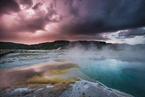 Lightining Illuminates The Sunset Sky Over Biscuit Basin, Yellowstone National Park by Bryan Jolley