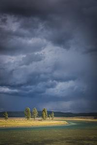 Sun Breaks Through An Afternoon Thunderstorm Over The Yellowstone River In The Hayden Valley by Bryan Jolley