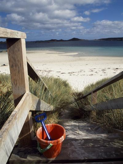 Bucket and Spade on the Steps Leading to the Beach Near Blockhouse Point, Tresco-Fergus Kennedy-Photographic Print
