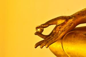 Buddha Statue Hands on Yellow Background