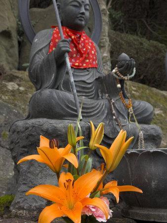 https://imgc.artprintimages.com/img/print/buddha-with-red-scarf-and-fresh-flowers-daisho-in-temple-miyajima-honshu-japan_u-l-p7tqwo0.jpg?p=0