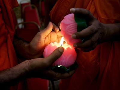 Buddhist Monks Light Candles During the Interfaith Special Prayers for Peace in Tibet-Shamshahrin Shamsudin-Photographic Print